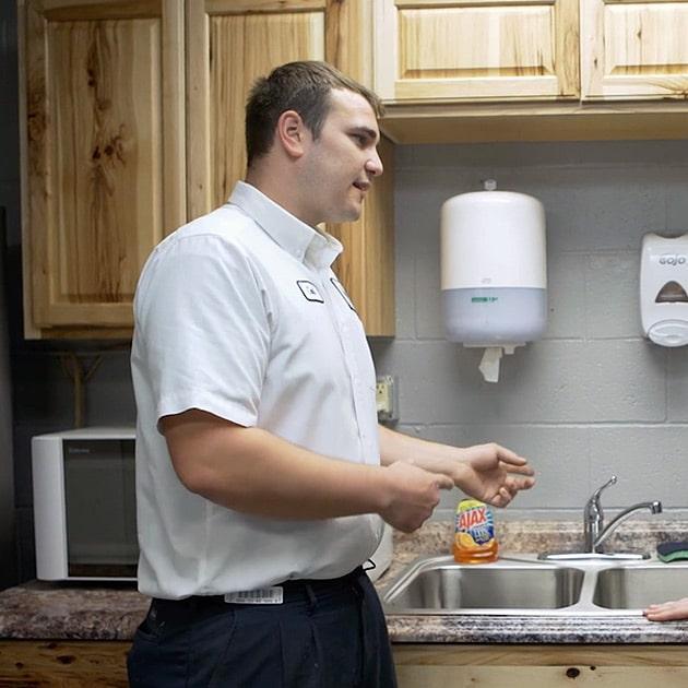 A Reimer plumber explains the drain cleaning process to a local homeowner in Buffalo, NY.