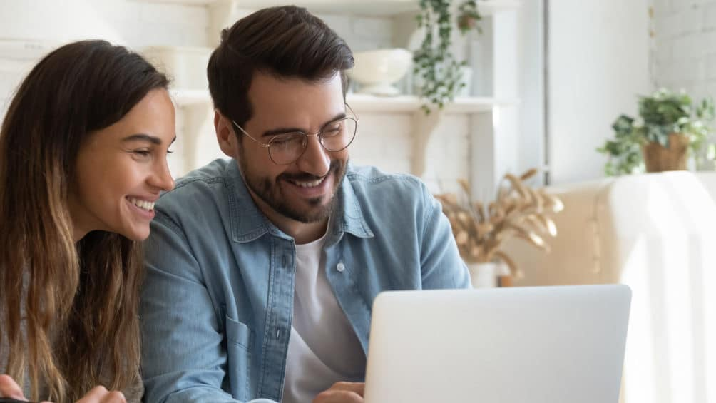 Two homeowners review our HVAC financing offers as they consider how to pay for a new gas furnace.