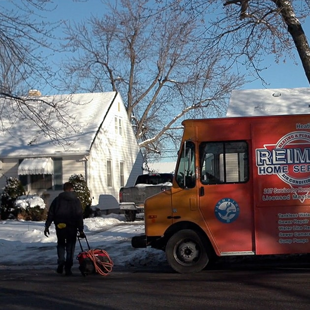 On a cold winter morning, a Reimer plumber walks to a home with frozen pipes here in Buffalo.